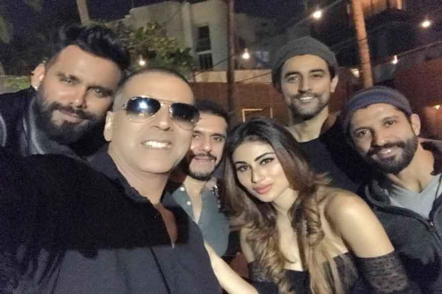 Mouni roy in gold film with akshy kumar